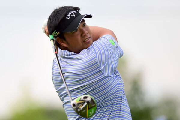 GREENSBORO, NORTH CAROLINA - AUGUST 01: Kiradech Aphibarnrat of Thailand plays his shot from the 18th tee during the first round of the Wyndham Championship at Sedgefield Country Club on August 01, 2019 in Greensboro, North Carolina. (Photo by Jared C. Tilton/Getty Images)
